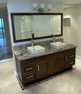 The challenge of this remodel was to create a spa like Master Bath from two small apartment sized bathrooms. The custom designed vanity is the center of the new enlarged bath suite.