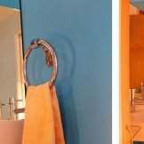 Photo montage showing different views of the redesigned powder room.