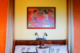 In the Master Bedroom the art becomes the focal point on the warm yellow tones of the wall.