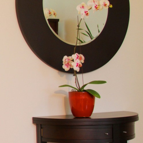 This entry foyer expresses the Asian simplicity of this residential remodel. The entry table and mirror are from Italy by Porada.