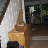 BEFORE PHOTO: The entry foyer to the townhouse was dark and the enclosed carpet stairway had a very dated look.