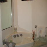 BEFORE PHOTO: The remodel included updating the powder room which had a dated corner sink and no storage.