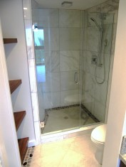 Custom shower with seamless glass enclosure keeps the space open.