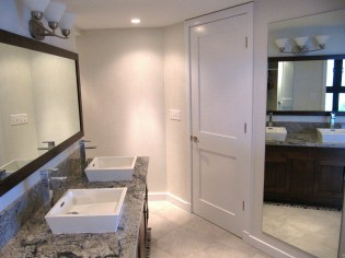 The vanity area has a gracious amount of space surrounding it and gives access both to the hall and Master Bedroom.