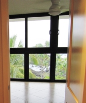 View into Master Bedroom with new floor to ceiling window wall in bronze by Coastal Windows, Honolulu.