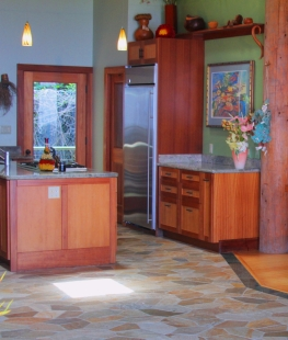 All the natural finishes from the bamboo cabinets to the natural quartzite floor edged in jade marble is the backdrop and balance to the bright bold colors.